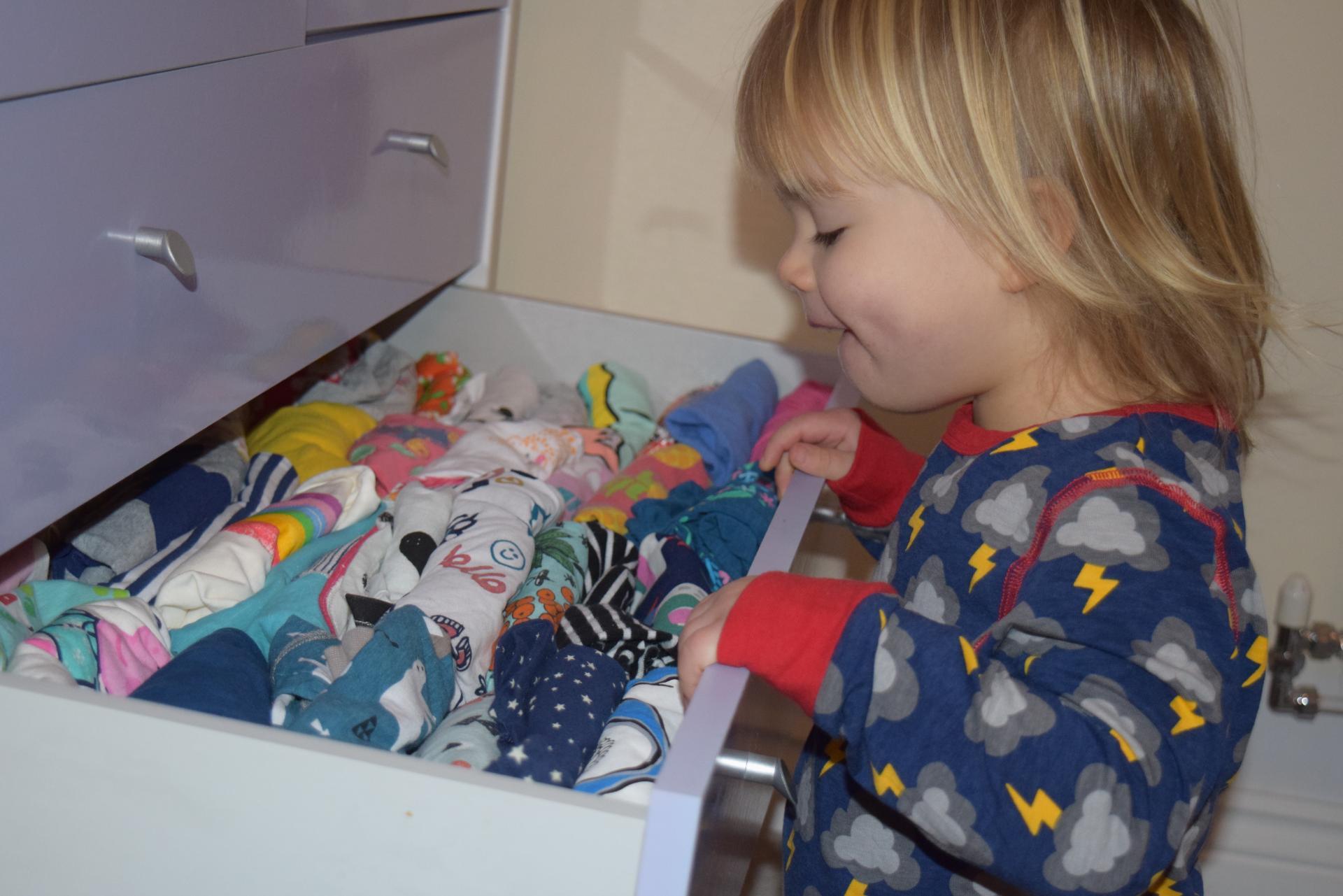 Eliza choosing clothes