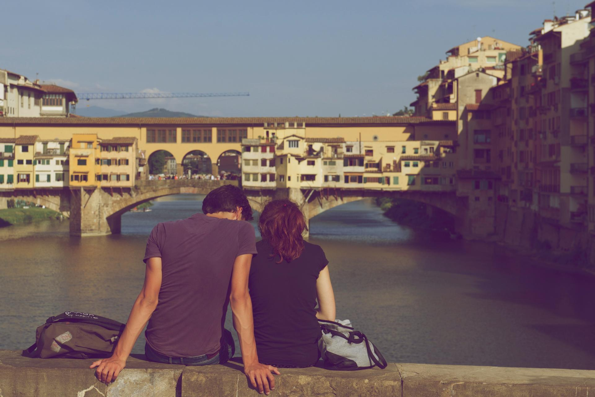 couple sat on bridge