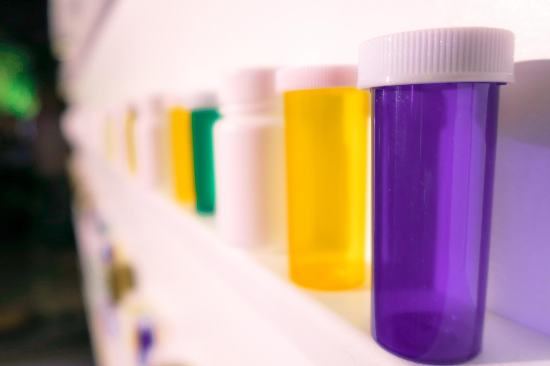 pharmacy pots on a shelf