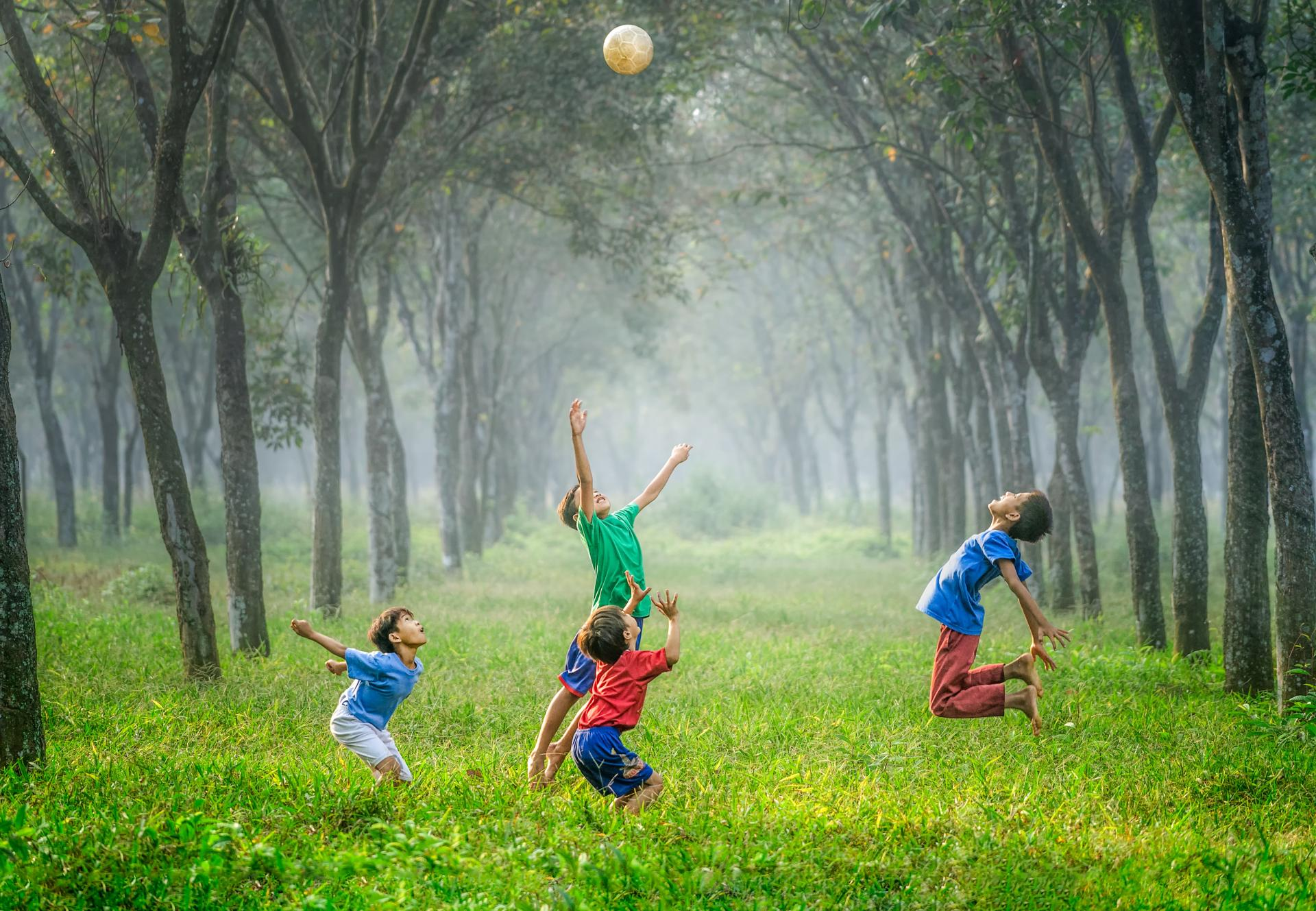 children playing football in a field